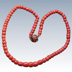 Faceted Coral Necklace With Carved Cameo Clasp