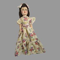 Elegant 1950's Hard Plastic Doll in Original Floral Gown