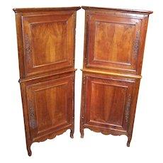 Pair French Louis XV - Louis XVI provincial walnut corner cabinets