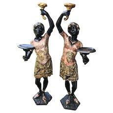 Pair of Venetian Blackamoors with Rare Rose Tint Silver Leaf Tunics