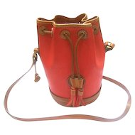 Dooney and Bourke Red Pebble Leather Vintage Saddle Bag. Rare Cylinder Shape.
