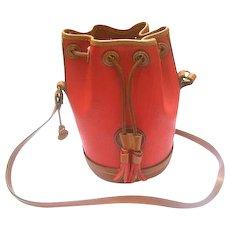 Dooney and Bourke Red Pebble Leather Vintage Saddle Bag. Rare Cylinder Shape.