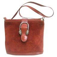 Rare Gucci Sterling Tiger Clasp Burgundy Suede Handbag. 1970's.
