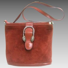 Rare Gucci Sterling Tiger Clasp Burgundy Suede Handbag. 1970's.