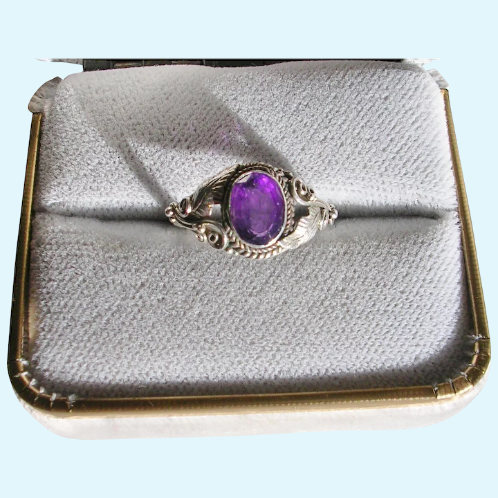 Sapphire and amethyst curling silver ring.