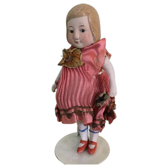 """Unmarked painted bisque 7"""" doll."""