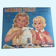 "Queen Holden ""Modern Dolls to Cut and Dress"" Eight Dolls with Complete Wardrobes."