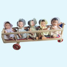 """Very Rare Madame Alexander Quintuplets in hard to find """"stroller""""."""