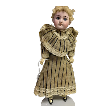 "12"" German bisque headed doll on a composition body."