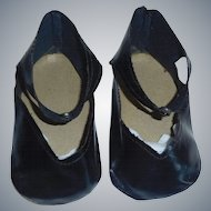Pair of Black Early Vintage Oil Cloth Center Snap Doll Shoes