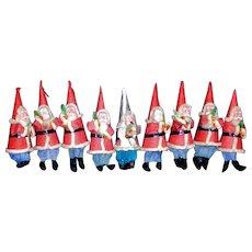 Nine Vintage Papier Mache Santa's