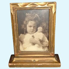 Sweet Early Small Framed Picture of a little Girl with her Doll