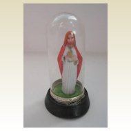 Miniature vintage statue Jesus in a glass dome