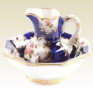 Antique miniature porcelain French doll floral pitcher & bowl set