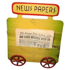 Antique doll train tin newspaper rack on wheels