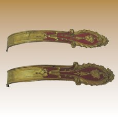 Antique French gilt deep red decorative metal tie back pair
