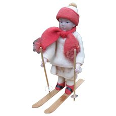 Antique German Heubach bisque doll on skis Christmas candy container