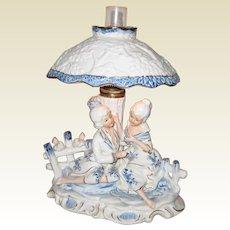 Vintage porcelain cobalt blue white Romantic figurine lamp