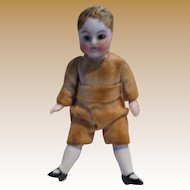 Antique small all bisque jointed doll Brown glass eyes
