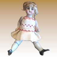Antique small all bisque jointed Girl doll Brown glass eyes