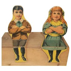 Two Paper LITHO Wood sitting antique Dolls