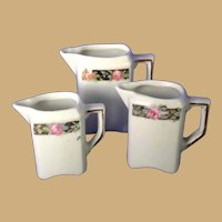 Antique German pink floral porcelain Kitchen miniature graduated Pitchers