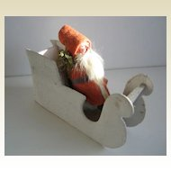 Antique German Putz Santa on a white mica sled