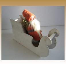 Antique German Putz Santa on a white mica sled