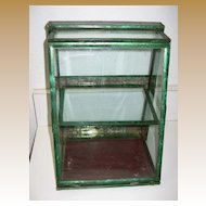Antique rare small green tin slanted display case showcase