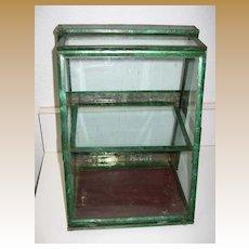 Antique rare small green tin slanted display case showcase