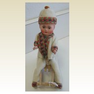 Antique Christmas German paper mache child on sled candy container Heubach type