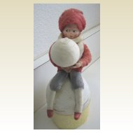 Antique German Heubach Googly eye Christmas candy container sitting on a snowball