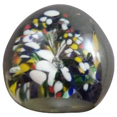 Vintage glass paperweight with tube flowers