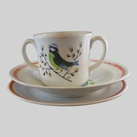 Child's set of plate, bowl and cup with bluebird design marked KB