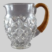 Vintage Pressed Glass Pitcher with Rattan Handle