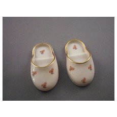 """Pair of  """"Leneige"""" porcelain miniature slippers with orange flowers and gold trim"""