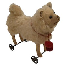 Steiff's Smallest, Early, And Absolutely Adorable Wool and Mohair Pomeranian on Metal Wheels With ID