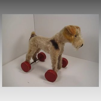 Steiff's Early Postwar Foxy Fox Terrier With ID on Eccentric Wooden Wheels
