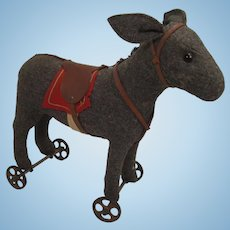 Steiff's Very Early Dark Grey Felt Donkey on Metal Wheels