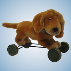 Steiff Bazi Dog On Eccentric Wheels With ID