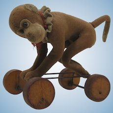 Steiff Early 20th Century Felt Monkey Pull Toy On Wooden Eccentric Wheels