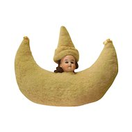 German Bisque Doll Head on Wool Crescent Moon