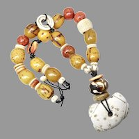 200+ Year Old Himalayan Conch Shell, Ethiopian Singed Amber Necklace