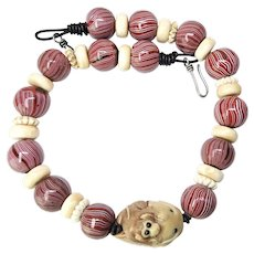 Carved Tagua Monkey Riding a Fish, Indonesian Glass Necklace