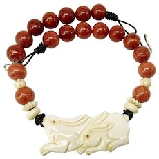 Carved Bone Rabbits with Red Apple Coral Necklace