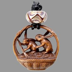 Carved Boxwood Rabbits in a Basket Pendant Necklace
