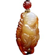 Carved Orange Agate with an Asian Boy Pendant Necklace