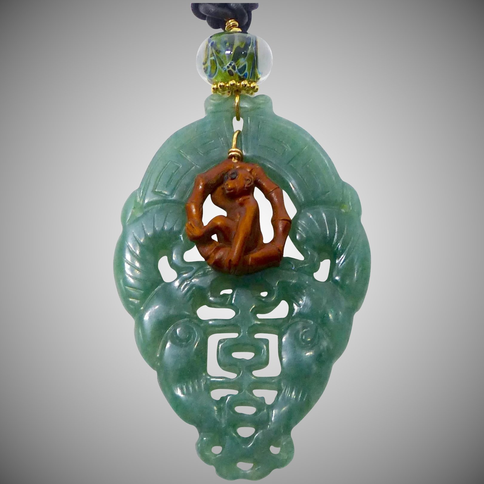 Carved green aventurine double phoenix boxwood monkey on a swing