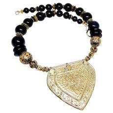 Antique Indonesian Gilt Chastity Piece with Black Onyx Necklace