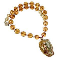 Carved Golden and Green Jade Fish Inside a Lotus Leaf, Faceted Baltic Amber Necklace